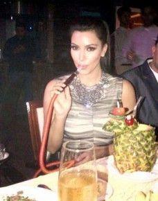 Kim Kardarshian having a hookah. ImageSource: Google