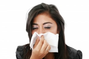 Girl sneezing/freedigitalphotos