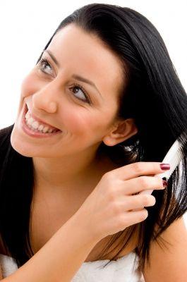 'Lady brushing her hair/freedigitalphotos
