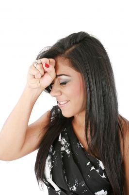 Woman Slaps His Forehead In An Oh-no Moment/freedigitalphoto
