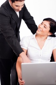 Couple romancing in office/freedigitalphotos