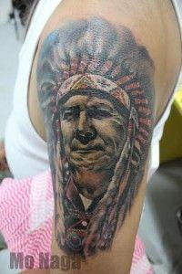 A tattoo by Mo Naga