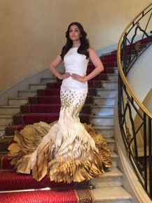 Aishwarya Rai Bachchan stuns in white and gold fishtail gown.