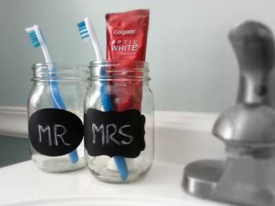 Tooth Brush holder: MAke use of your old mason jar by making it your bathroom accessory: Just paint your old mason jar and use it to keep your toothbrushes.