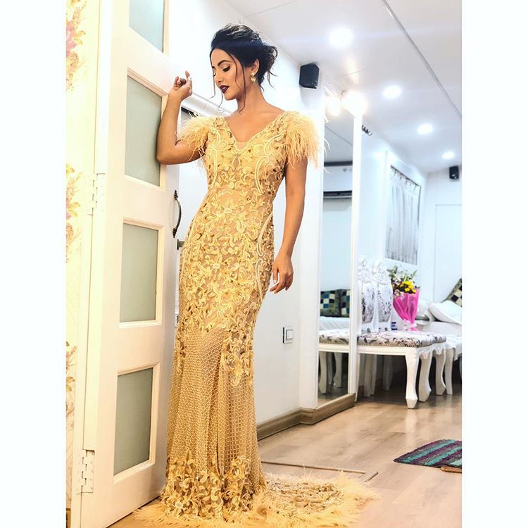 Looking amazing in Golden gown