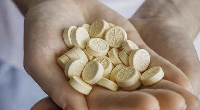 Vitamin C supplements in hands