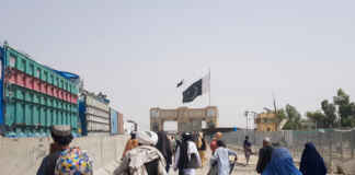 People cross Friendship Gate at Pakistan-Afghanistan border town of Chaman